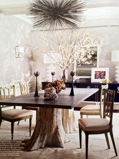 Hollywood Regency Living Room. I love the tree trunk legs on the dining room table
