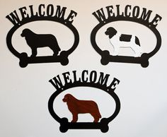 """These Newfoundland Oval Welcome signs are crafted from 16 gauge durable rust resistant metal and sealed with black acrylic enamel. The Landseer and Brown signs are hand painted. Size: 9.75""""w x 8.25""""h."""