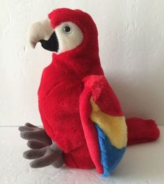 """K M International Scarlet Red Parrot Macaw Bird Hand Puppet Plush Soft Toy 9""""  Soft and Clean! No rips, stains, or tears. Measures about 9"""" tall when sitting. Like new condition.  Track Page Views With  Auctiva's FREE Counter"""