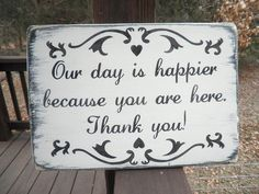 """Wedding sign, """"Our day is happier because you are here Thank You""""  white distressed with black."""