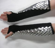 Scuffed and a bit battered looking silver scales show the marks of battle in these Dragonhide Scalemail Armor knitted gauntlets. Designed to go all