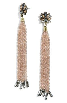Old-world glam meets contemporary style with these dramatic drop earrings made from sparkling seed beads and crystal clusters.