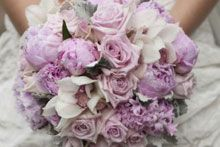 peonies, cymbidium orchids, roses, hyacinths a touch of dusty miller