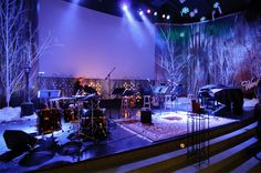 winter set design - love how the rug makes the stage feel welcoming with the harsh snowy forest around the edge Stage Set Design, Church Stage Design, Christmas Stage Design, Christmas Trees, Christmas Decor, Youth Group Rooms, Concert Stage Design, Painted Branches, Stage Lighting