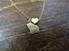 Georgia Love - State Charm Necklace. Since people out here love TX so much, I think I should get a GA necklace!! #wesleyancollegega