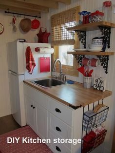 Best Tiny House Kitchen and Small Kitchen Design Ideas With some smart use space, a tiny kitchen can be a just as welcoming and pleasurable location to spend time. tag:tiny house kitchen design ideas, tiny house kitchen cabinets and storage, tiny hous Diy Kitchen Storage, Kitchen Shelves, Kitchen Cabinets, Open Shelves, Kitchen Island, Kitchen Appliances, Kitchen Sinks, Red Cabinets, Window Shelves