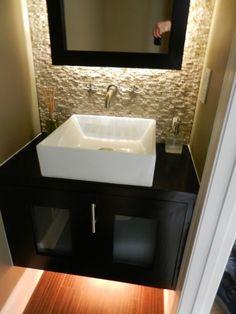 My new powder room that my awesome husband renovated!     My half bath renovation. Custom backlit mirror and vanity.