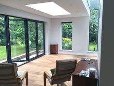 Extension in Winsley built of Farmington natural stone with engineered oak flooring, underfloor heating, aluminium windows and an EPDM flat roof.
