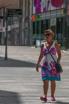 Style on Dutch Streets #2 Almere Netherlands July 2013 Amazing how she is wearing a dress that seems to be coordinated with the shop front behind her!