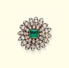 AN ANTIQUE EMERALD AND DIAMOND FLORAL BROOCH  Designed as a square-shaped emerald to the old-cut diamond petals, mounted in silver and gold, circa 1840, 3.9 cm. wide