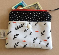 Women's Nautical Fabric Wallet Zipper Purse Credit Card Holder. Quality handmade FABRIC ZIPPER PURSE designed with premium quilt shop nautical mini fish fabrics. This small fabric wallet has been created with fleece interfacing to hold its shape and also with woven interfacing for strength and durability. Inside is secure section with zipper closure. Outside has Kam snap on a 3/4 high pocket with cutest little red fish swimming around. This nautical wallet can be machine washed and dried…