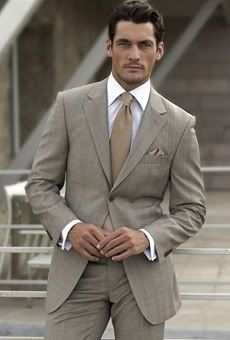 The charm of Italian style, this two-piece dress color mud, with slim fit shirt 100% italian cotton, double twisted neck, Italian, light, brown raw silk tie and pochet square coordinated. The Italian style of Francescovalentino Arpaia.
