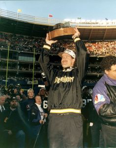 Coach Cowher raises his first AFC Championship Trophy, on his way to Super Bowl 30