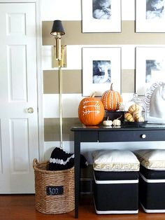 Add personality and pizzazz to your front interior entryway with a collection of tribal-inspired, no-carve pumpkins: http://www.bhg.com/halloween/outdoor-decorations/pretty-front-entry-decorating-ideas-for-fall/?socsrc=bhgpin110614tribalpaintedpumpkins&page=6