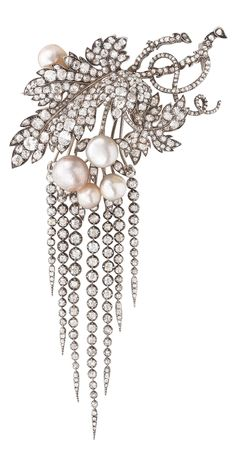 An antique gold, silver, diamond and Oriental pearl en trembleuse brooch, late 19th century. From an old European aristrocratic family's collection.