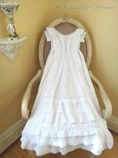 """Stunning Antique Victorian Lavishly Ruffled Broderie Anglaise Christening Gown Featuring seemingly endless ruffles of broderie anglaise on the softest pure white cotton lawn in a princess a-line style. Delicate pintucks are also repeated down the front, as well as all along the hem. Ruffles cascade down the front, as well as around the sleeves, and hem. The gown closes at the back with delicate silk cording. This precious gown is 38"""" long. Truly an heirloom piece for your baby."""