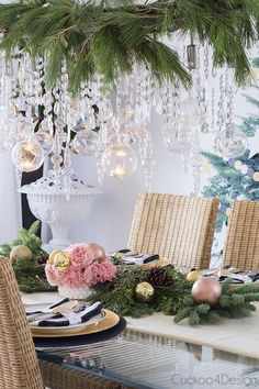 Christmas table setting with pink, copper and gold mixed with fresh greenery and icicles