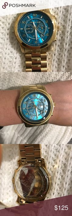 Michael Kors Watch This watch is part of the Watch Hunger Stop campaign from Michael Kors. It is a Gold Stainless Steel/ Quartz 45 mm Watch. The face is a Turquoise. Michael Kors Accessories Watches