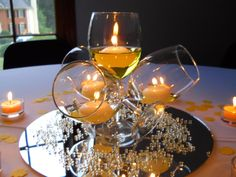 Yellow Centerpiece -http://thepartypopper.wordpress.com/2011/06/28/50-and-fabulous-surprise-party-decor/#
