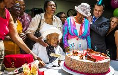 """Susannah Mushatt Jones, known as """"Miss Susie"""", celebrates her 116th birthday with family members, local dignitaries, and friends in the Brooklyn borough of New York. She's currently the world's oldest living person and is the daughter of sharecroppers and granddaughter of slaves. Lucas Jackson / Reuters"""