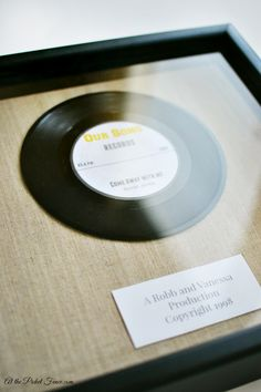 Personalized 'our song' framed record. Makes such a great Valentine's Day gift! At the Picket Fence.com bHome.us #bHome.us