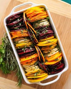 Herb Roasted Root Vegetables || think of them like hasselback potatoes, but with more colours! This nutrient-dense, healthy side dish is a perfect one for fall and winter meals || #glutenfree #vegan #paleo || Eat Spin Run Repeat