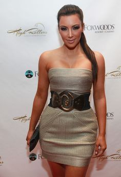 Kim showed off her signature curves in a gold bandage dress.
