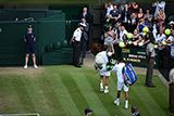 Nick Kyrgios and Rafael Nadal leave Centre Court after their match