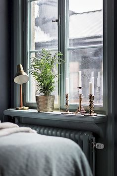 Candle holders in the window bedroom inspo grey, blue bedroom, bedroom deco Bedroom Inspo Grey, Home Bedroom, Bedroom Decor, Window Sill Decor, Interior And Exterior, Interior Design, Corner House, Bedroom Windows, Piece A Vivre