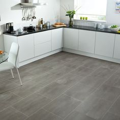 Vinyl kitchen flooring is a very popular choice by homeowners. Vinyl kitchen flooring offers many benefits to the homeowner who has children, pets, or lives an active lifestyle. These floors are ve… Grey Laminate Flooring, Karndean Flooring, Vinyl Flooring Kitchen, Kitchen Vinyl, Modern Flooring, Linoleum Flooring, Luxury Vinyl Flooring, Luxury Vinyl Tile, Stone Flooring
