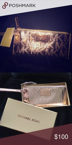 NEW Michael Kors wristlet!! It's brand new! Comes in the box and has the tag still attached. Never used. In the color rose gold. Michael Kors Bags Clutches & Wristlets