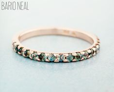 Custom Variation on our Half Eternity Band featuring blue-green sapphires and recycled 14kt rose gold.