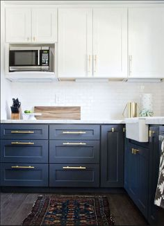 white and navy cabinets, brass drawer pulls, throw rug