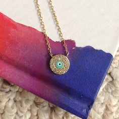 Gold Evil Eye Necklace I got so many complements while wearing this necklace. It is sterling silver, but played with gold, it does not turn colors. Boutique Jewelry Necklaces
