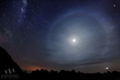 Milky Way and Lunar Halo Over Malaysia.  The bright star Arcturus lies in the constellation of Boötes, 34 light-years from Earth. The star has an apparent magnitude of -0.04 and an absolute magnitude of 0.2. Image: A lunar halo glows over Mersing, Malaysia. Venus appears at the bottom right with Saturn near the top of the moon. The fourth brightest star in the night sky, Arcturus, is seen near the top right corner. [See our facts about Arcturus.]