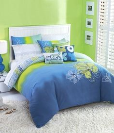 comforter and throw pillows by Roxy