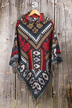 Can never figure out how to wear a poncho but love the beautiful pattern on this one.