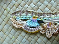 Way to Add Color to Crochet. Use watercolors on white yarn, after the piece is crocheted.