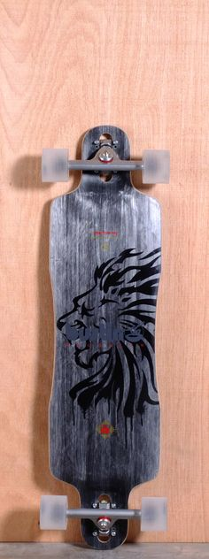 """The Bustin Sportster Pro Longboard Complete is designed for Freeride, Sliding, Downhill and Cruising. Ships fully assembled and ready to skate! Function: Freeride, Sliding, Downhill, Cruising Features: Fully Symmetrical, Drop Through, Concave, Rocker, Wheel Cutouts Material: ThremoCarbon Construction, Maple Ply Length: 37.5"""" Width: 10"""" Wheelbase: 29.5"""" Thickness: 1/2"""" Hole Pattern: New School, Old School Grip: Black"""
