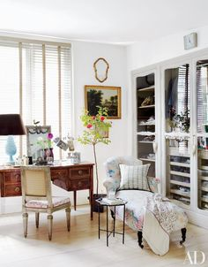 Fronting the closets in the dressing room are Louis XV–style doors passed down from the designer's grandmother | archdigest.com