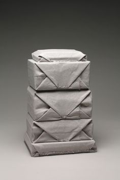 grey sculpture by Luke Maddaford.....it would be interesting to stitch close a cloth wrapped present for the right type of person who would appreciate such a wrapping.