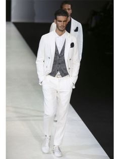 Giorgio Armani plays it cool with waist coats and pocket squares. Image courtesy: AP