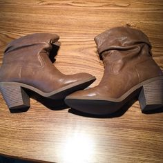 Ankle tan boots with ruched top Tan boots with a smaller heel. Looks somewhat like cowboy boots. Have only been worn a handful of times. Right shoe has a small scuff at the top of the boot as pictured. Other than that, great condition Shoes Heeled Boots