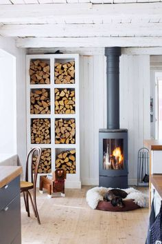 Modern And Cool Home Wood Burning Stove A Scandinavian space with a modern and cool wood burning stove plus an elegant open storage unit for firewood. Cabin Fireplace, Fireplace Design, Freestanding Fireplace, Firewood Storage, Garden Deco, Log Burner, Living Room Designs, New Homes, House Design