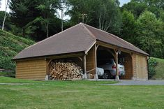 Three Bay Garage and Carports with full hip and logstore. Roofed with Clay tiles at 35 degrees