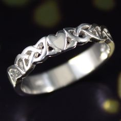 Authentic Irish celtic ring, sterling silver modern claddagh design. by IrishJewelryDesign on Etsy https://www.etsy.com/listing/226162950/authentic-irish-celtic-ring-sterling