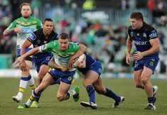 Jack Wighton of the Canberra Raiders is tackled during the round 12 NRL match between the Canberra Raiders and the Canterbury Bulldogs at GIO Stadium on May 29, 2016 in Canberra, Australia.