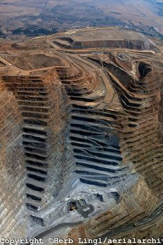 Bingham Canyon Copper Mine, Utah...world's first open pit copper mine and world's largest man-made excavation.  At the top, it is 2 1/2 miles across.  This mine has yielded 14 million tons of copper, 18 million ounces of gold,  157 million ounces of silver.