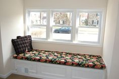 Custom window seat cushion made with Bloomsbury Onyx fabric, which features a black background with lovely flowers. CushionSource.com Customer Photo