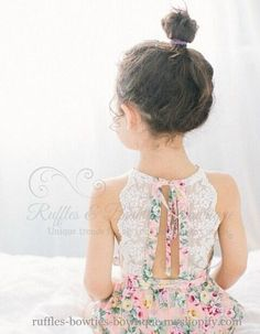 This adorable romper, is as sweet as can be, with a delicate floral print.